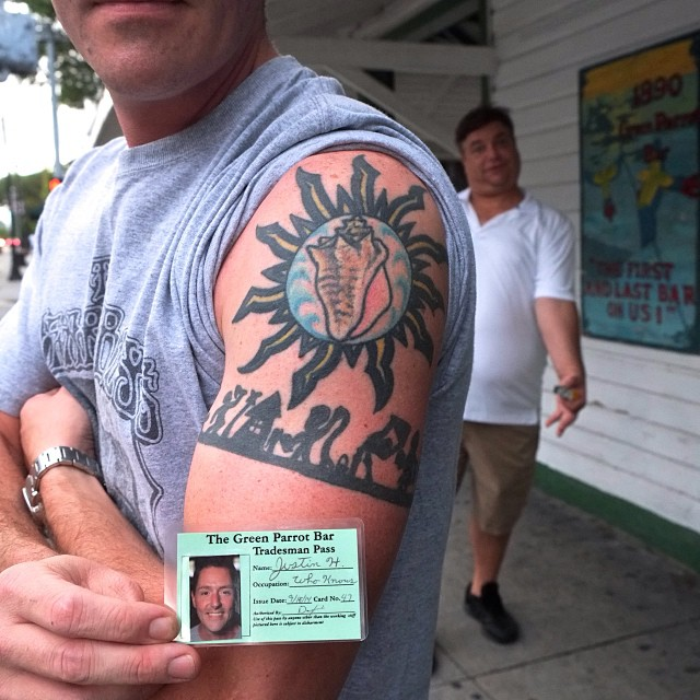 Another great tattoo. This time it's Justin, sporting his new Tradesman's Card to match his Tradesman's tattoo. Atta boy!  Lew of The Walking Dead in the background.