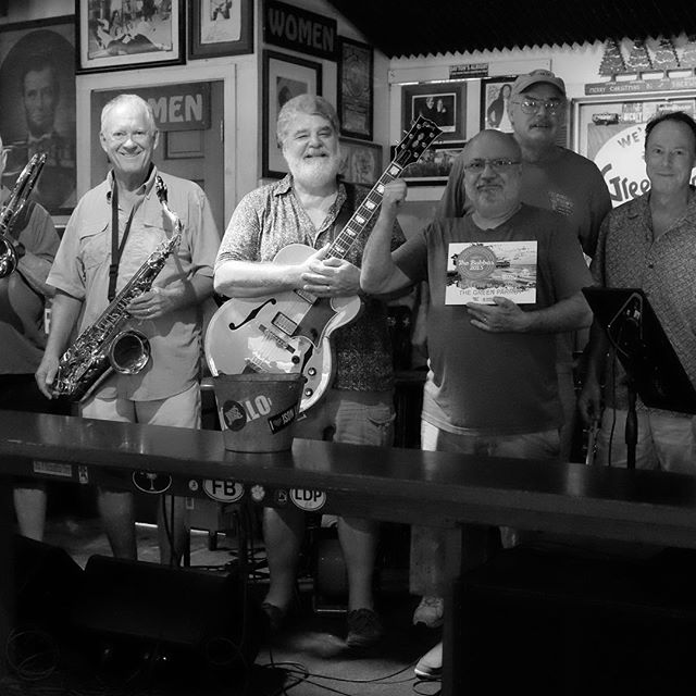 Last night The Weekly Newspaper announced that The Green Parrot was voted Best Live Music Venue in Key West in their recent Best of Key West Poll. As I hold the award today,  pictured behind me are our Sunday Jazz ensemble, representing just a few of the many, many musicians, local and otherwise,  who mount our stage and continue to weave music into the cultural fabric of Key West, I thank them, without them this honor would not have been possible.  I would as well extend our appreciation to  musicians everywhere,  for continuing to delight us, and inspire and enrich our lives. I'd like to also thank all our staff here for their professionalism,  and making The Parrot such a welcoming, warm environment for our patrons to enjoy such great music, and thanks to those patrons, the best anywhere, for their loyalty, enthusiasm, and passion for music, and for making the musicians feel so welcome and appreciated that  they cannot help but deliver their best performances each time they step out on our stage We promise to remain your