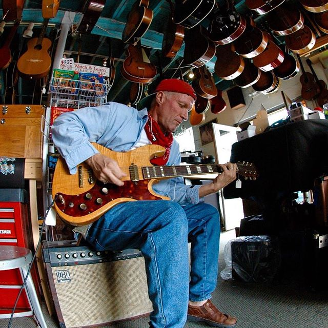 Taken several years back, Key West musician R.B.Tolar test-drives a rare vintage Kay 300 Solid body double cutaway Electric Guitar in Tim Wegman's A440 music store on Caroline Street. We purchased the guitar the same day to have our  touring bands, the real road warriors, sign it for us before heading back out on the road. #carolinestreetmusic #keywest #greenparrotbar #vintageguitars #a440music #keywestmusic #rbtolar #roadwarriors