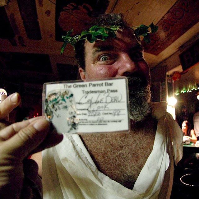 Tomorrow, Thursday, September 17 5 PM greenparrot tradesmen's appreciation day. Come and get your greenparrot tradesmen's pass. You don't even need a job to get one! Pictured here  with his freshly-minted, hand-painted Tradesman's Pass is our dearly-departed and greatly missed  Coy Lebeau, New Orleans transplant, , Key West chef, raconteur, NOLA downtown denizen, music maven, fess head. Zule Krewe member #greenparrotbar  #coylebeau #NOLA #chef  #fesshead #tradesmansappreciationday #zulusocialaidandpleasureclub #zulukrewe