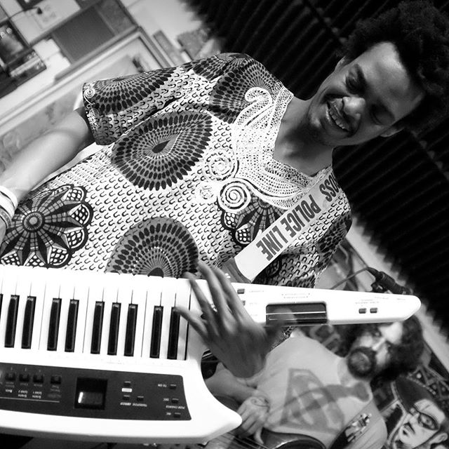 "Pictured is Spiritual Rez keyboardist, Mohamed Araki,  from Sudan,  a talented and kind-hearted African, a truly kind person,who comes equipped with an arsenal of dub sounds on Keytar, Melodica and space age keyboards, but on top of his world class musicianship,  Araki, a student at the prestigious Berklee school of music, has recently gathered 35 Berklee musicians to perform with guest artists from Sudan,  Emmanuel Jal, Asim Gorashi, Mohamed Tahir, and Abu Araki Elbakheet, Araki's father. ""Sudan is heir to an extremely rich tradition of musical, dramatic, and artistic expression, yet this music has not been well exposed or documented due to civil and political turmoil in the country,"" says Araki. ""The concert's title, Al-Murtaja, means the thing or person people are waiting for, and this concert fulfills that wish by featuring musicians from all parts of Sudan to create a sense of shared cultural identity."" A recording session has been arranged for all of the musicians and a forum and multimedia exhibition including traditional clothing and food and photographs organized by Araki will educate students about Sudan in the days preceding the concert.  In addition, leading up to the concert, the Berklee Media Center will host a screening of Beats of the Antonov, a documentary about music, identity, and war in the Sudan.  #greenparrotbar #spiritualrez #sudanese_shoutout #sudanese_stars"