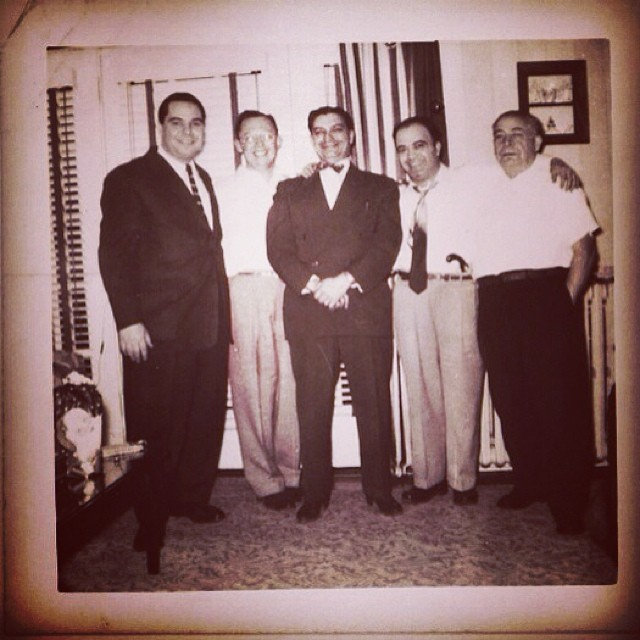 "On this Father's Day I'd like to taken a moment to honor not only my father, God bless his gentle soul, but some of the the other men in our family who influenced me, each in their own special way. Sadly all of the men in this photo are now gone, a few of them way too soon.  On the far right is my maternal grandfather, John Cardona, On the far left in the photo is his son, also John, In the center of the picture, with the bow tie and pencil-thin moustache, is my maternal grandmother's brother, my great uncle, Carmen Donato. On his right is my uncle Dick, And that leaves Al, my father.I don't know what to say about him that would really do him justice. As I said earlier, he was the gentlest of souls. He was soft-spoken, patient, loving, and never-comlaining, all this in spite of the fact, or perhaps because of the fact that he had a childhood that is difficult for me to even imagine, His father died when he was just 3, in the Spanish Flu pandemic in 1917. There was no social safety net for anyone in those days, let alone newly arrived immigrants, except the meager help that other newly-arrived family members or paisans could provide , or what little charity the catholic church could offer to his young widow and her five children. Because his mother could not support them all Al was sent to a Catholic orphanage in West Philadelphia till he was 13. Years later when I was in college I volunteered to help chaperone field trips for kids in a local orphanage and when I told Al, he cried.  You would think that the residue of his childhood like his would be bitterness or contempt but instead he emerged to become a man with a deep well of humility, optimism and grace. As my brother once said of him, ""It's as if the guy never had a bad day in his life""."