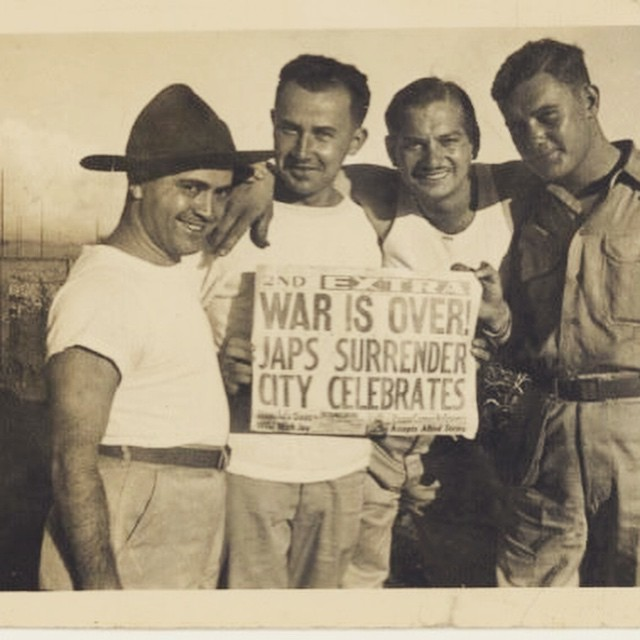 "This being Memorial Day  thought I would share this photo.  That's my father, Signal Corps Staff Seargant Al Vagnoni on the left, wearing the hat and the impish grin. Oh, wait, they're all grinning.  I'm picturing Al now,  sitting with his headphones on,  in a tiny, steamy radio shack in the middle of a vast pineapple field on the westernmost tip of the Hawaiian island of Oahu on that August  day in 1945, the day the Japanese surrendered.  Al was the radioman on duty who  received the first encoded message announcing  the Japanese surrender. He then passed the message on to San Francisco to be forwarded to Washington, D.C.  After passing the message on,  Al tore off  the piece of tape containing the historic bit of code and  that historic spool of tape sits in a tiny box in a drawer in brother's house today.  In fading ink, he caption on the back of the photo reads, ""Now what do you think we are so sad about."