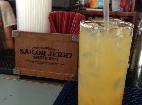 sailor jerry and pineapple juice at the green parrot