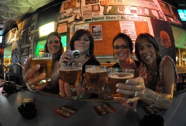 Photo of people enjoying happy hour drinks in Key West